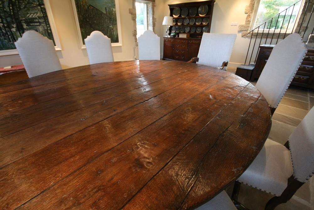 a large handmade oak oval rustic dining table made for a client in london