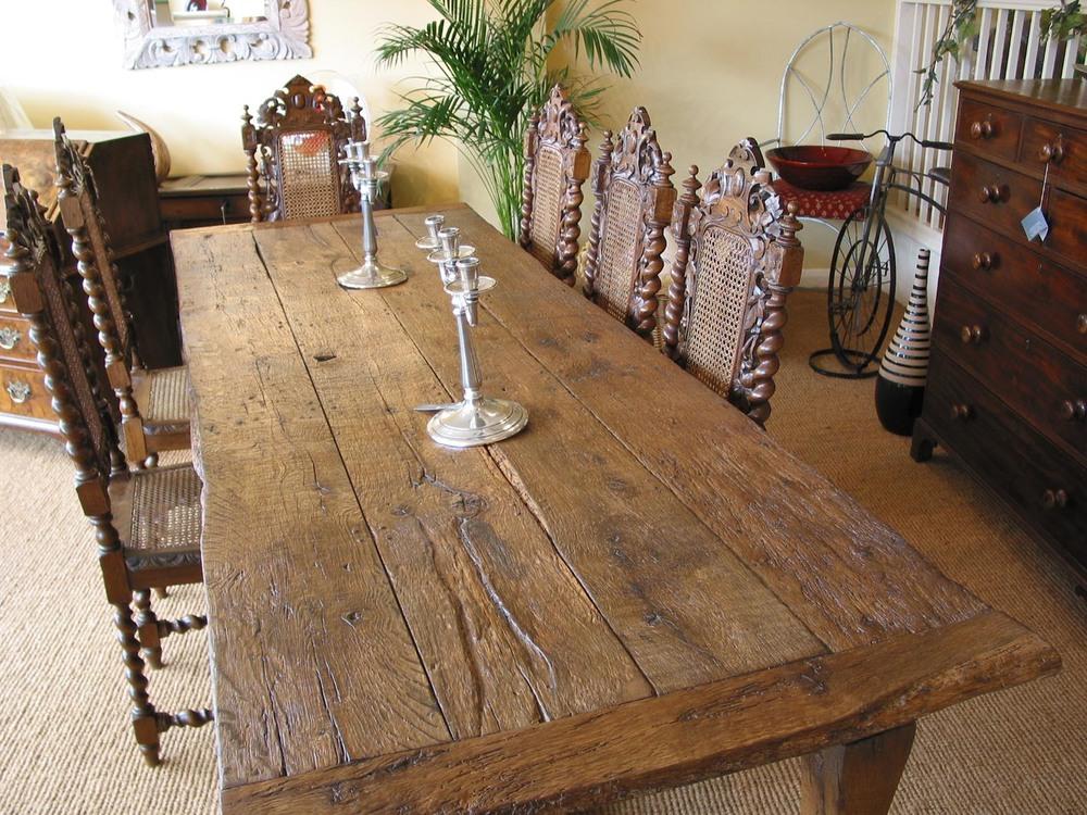 An oak refectory table handmade from antique reclaimed oak