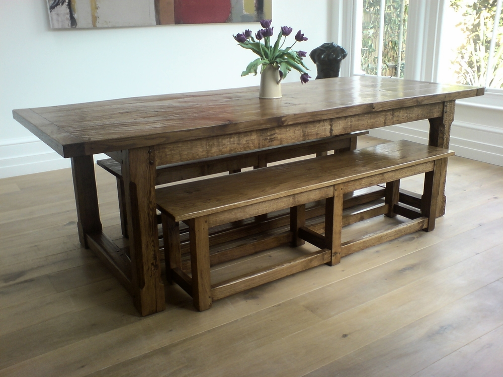 Bespoke oak dining table with matching benches