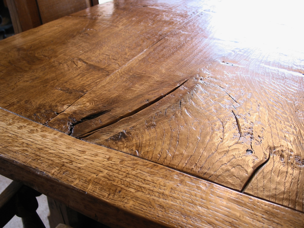A large oak dining table - handmade by vincent reed
