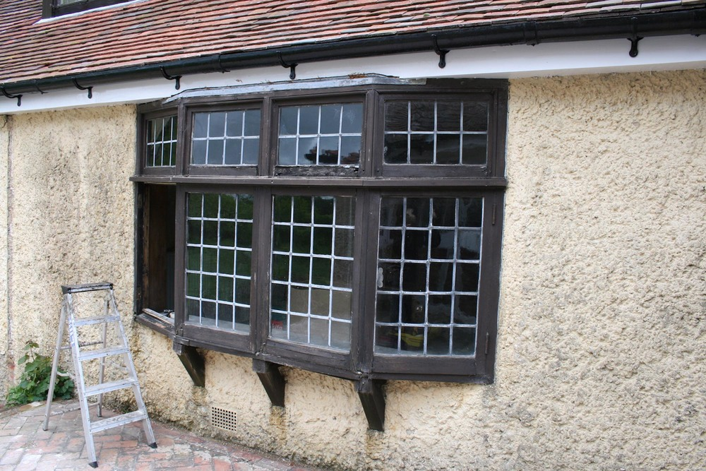 An arts and crafts oak canted bay window by ballie scott before restoration hampshire