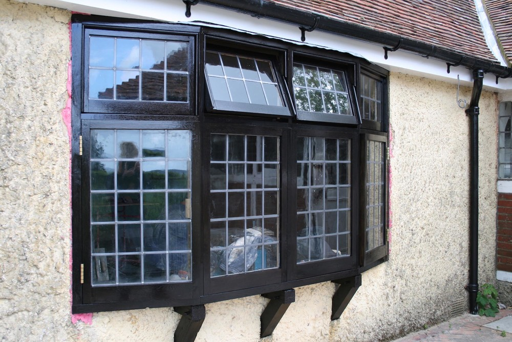 a restored oak bay window and leaded light glass panels reinstated