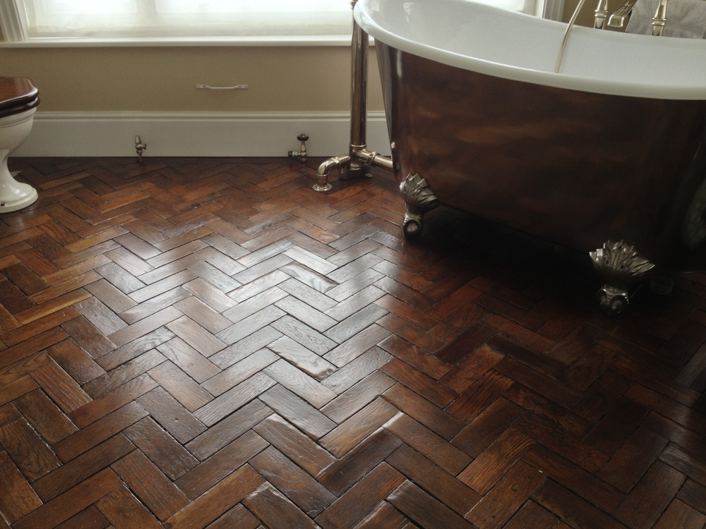 reclaimed oak parquet flooring in a bathroom