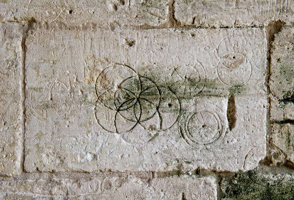 Marks found on the walls of Tithe Barn to protect crops