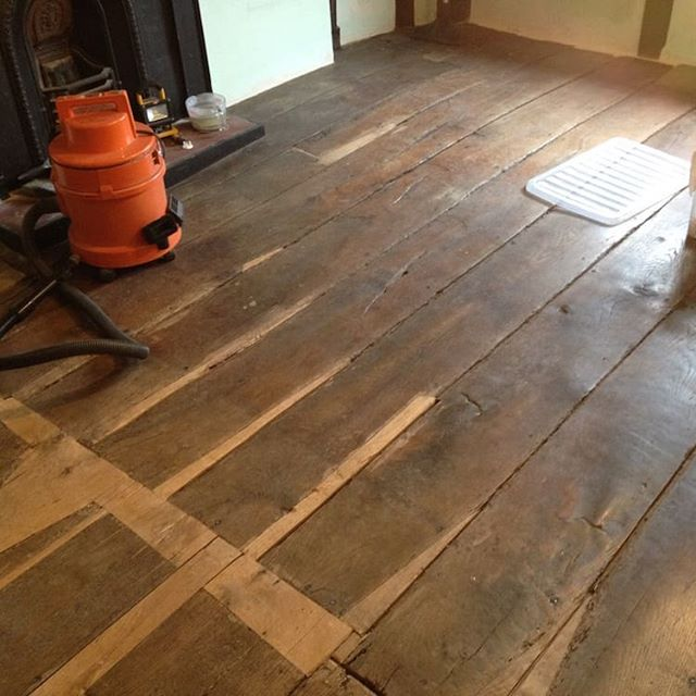 Patch repairs to a 16th-century oak floor
