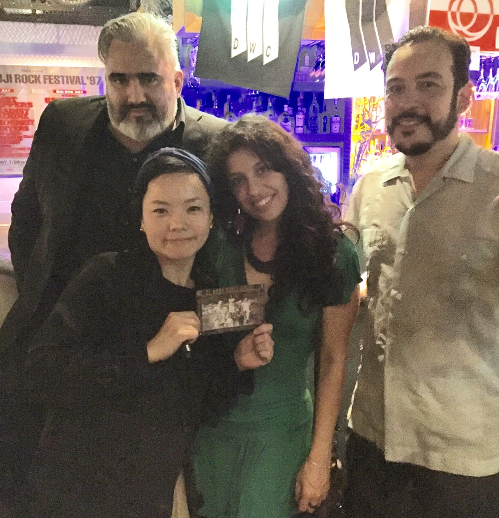 With one of our fans who designed the flier for our show at Do With Cafe