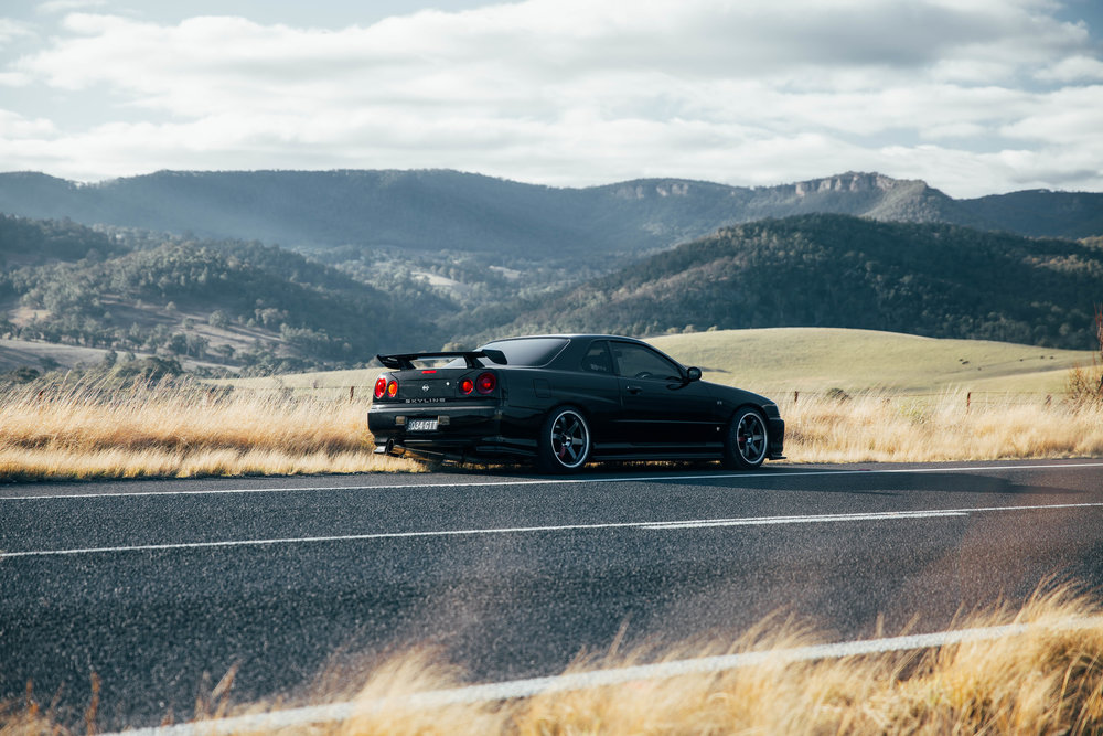 My R34 parked on the side of the road in Oberon for my Stay Driven look book. I can't get enough of the rolling mountains in the background.