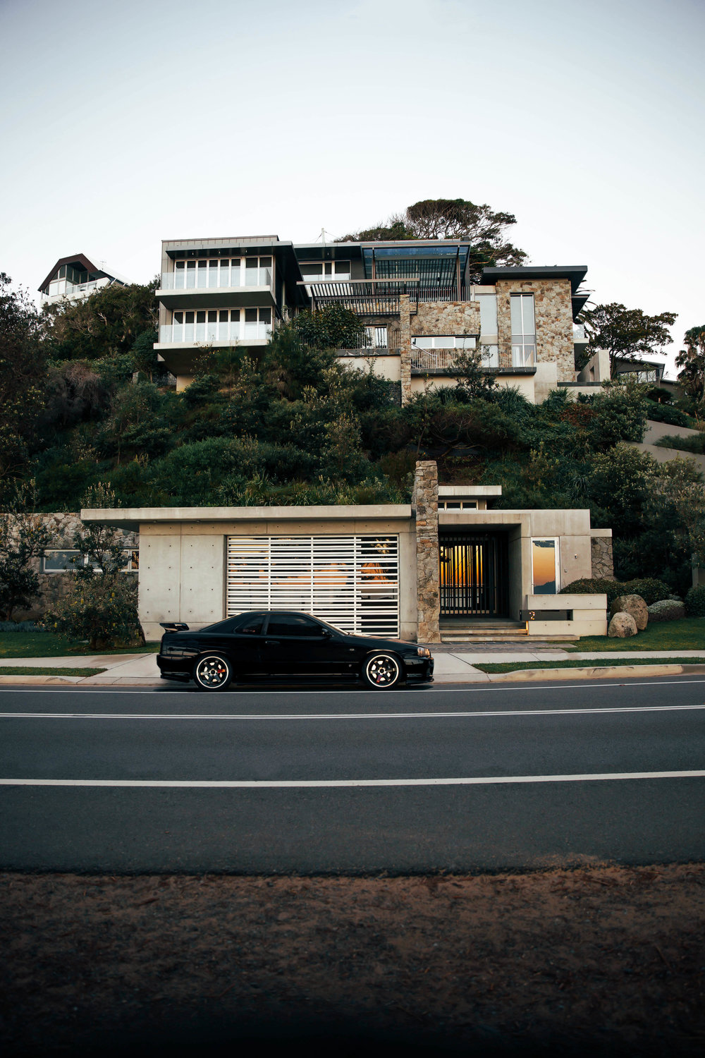 My two favourite things. Cars and Architecture. This was taken at 6AM outside my favourite house at Palm Beach, after I wrapped up my first ever Stay Driven video.