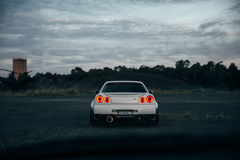 I took this of HH00NN's widebody R34 whilst following behind in my R34.