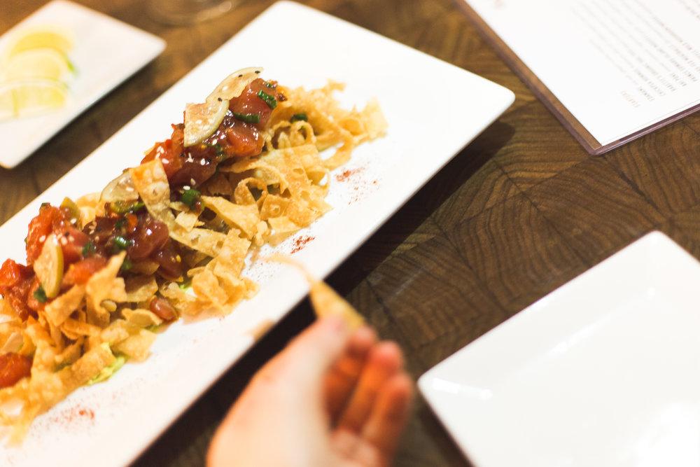 Ahi Poke - With sesame / avocado / togarashi / pickled lime / crisp wonton's