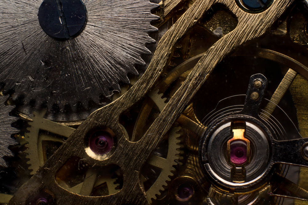 A macro image stack of the gears in an open faced watch.