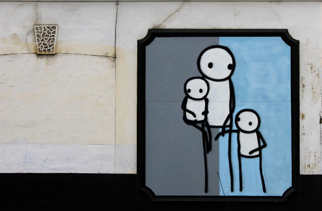 Mothers with young children are the most time poor demographic in Australia, so why is the Federal government focusing on getting them into paid employment?  Photo of street art by Stik .