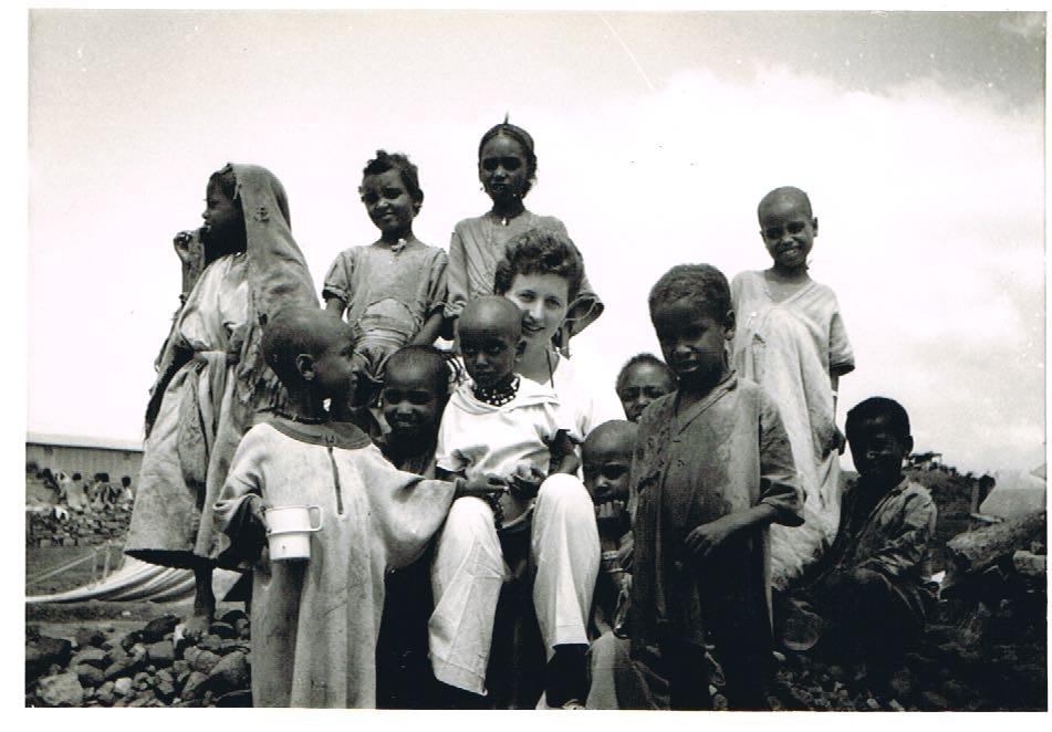 Singing with the children in Famine Relief Shelter, Mekele, Tigre, Ethiopia. 1985