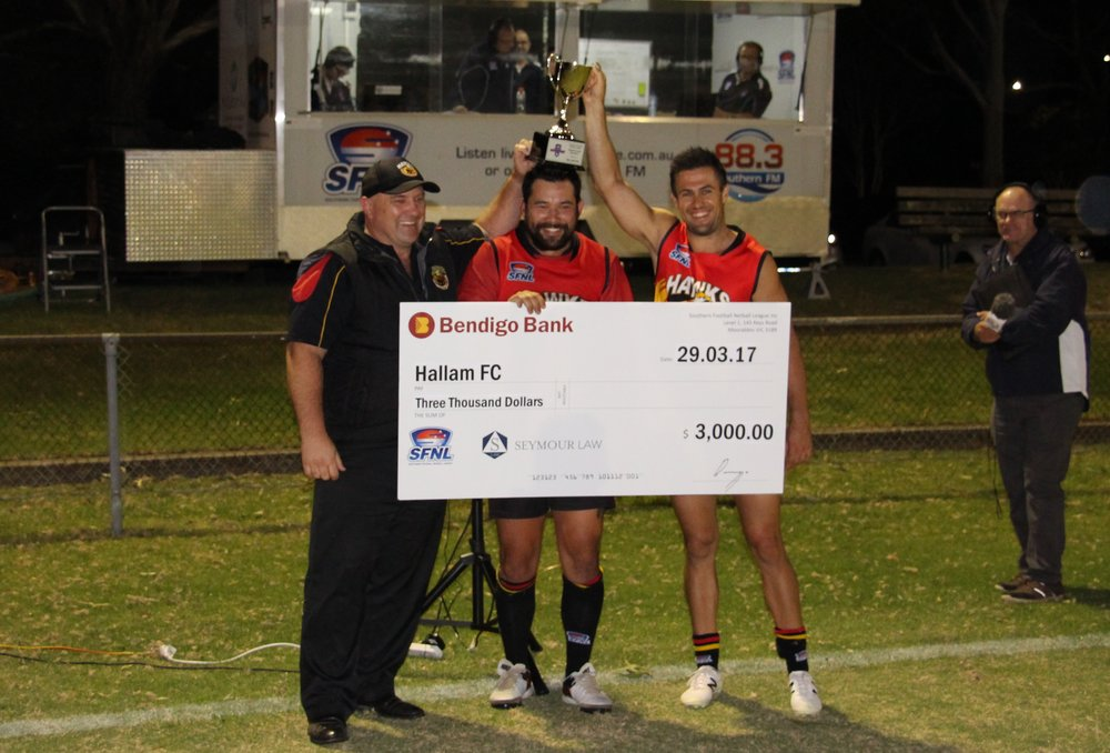 Hallam coach Scott Slater and co-captains Manny Peresso and Stephen Chin are present with the trophy and $3000 cheque.