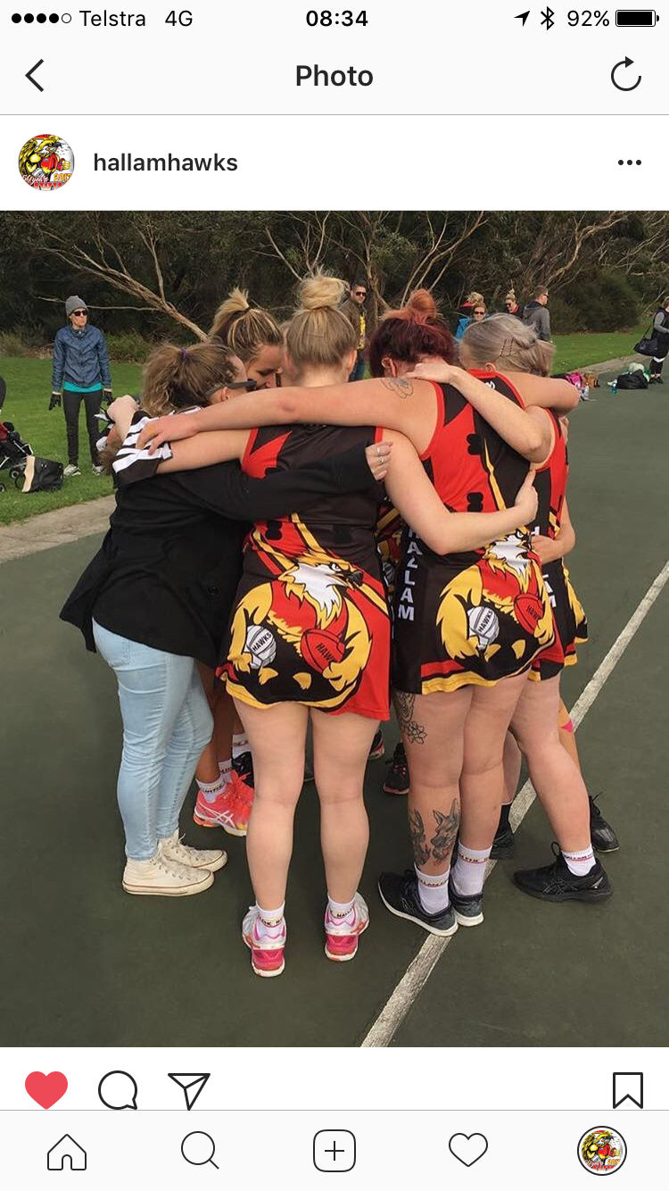 Netballers in there huddle at half time