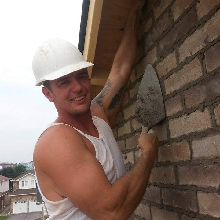 Mat laying bricks with a smile.jpg