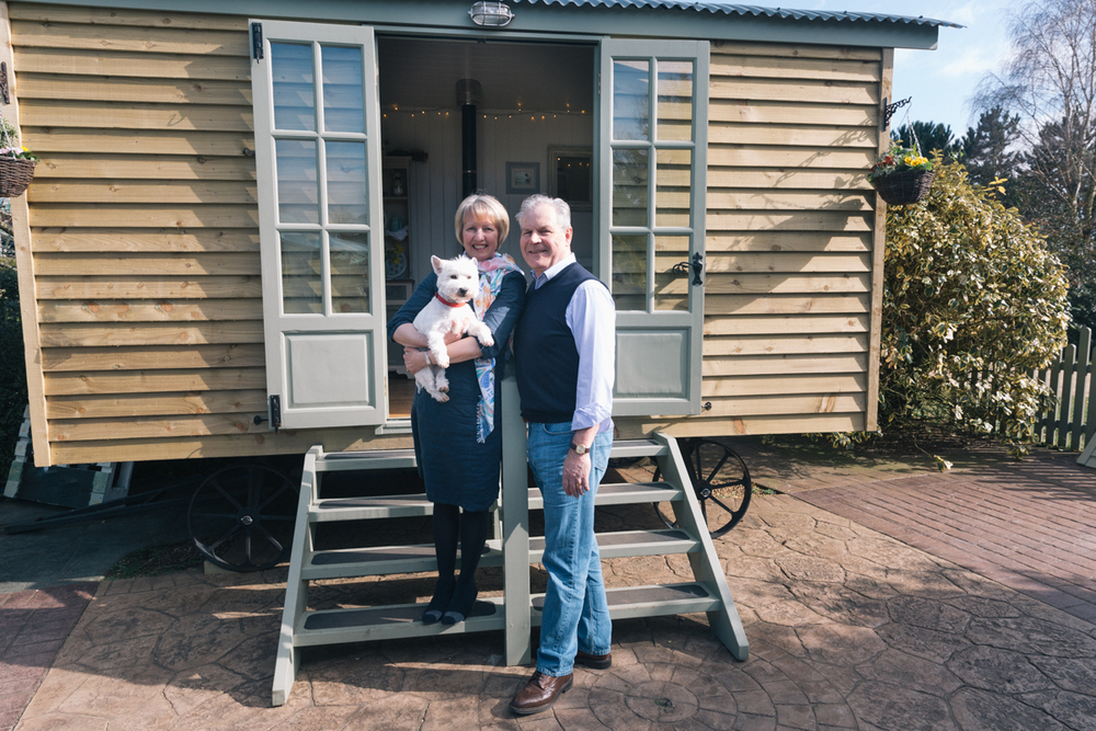 Cathy and Hugh Roberts with pet Ruby on the steps of their Red Sky Shepherd's Hut as featured in the Evening Standard today. Once needing to commute into London every day, Hugh can now commute to the bottom of his garden to use his delightful new home office!