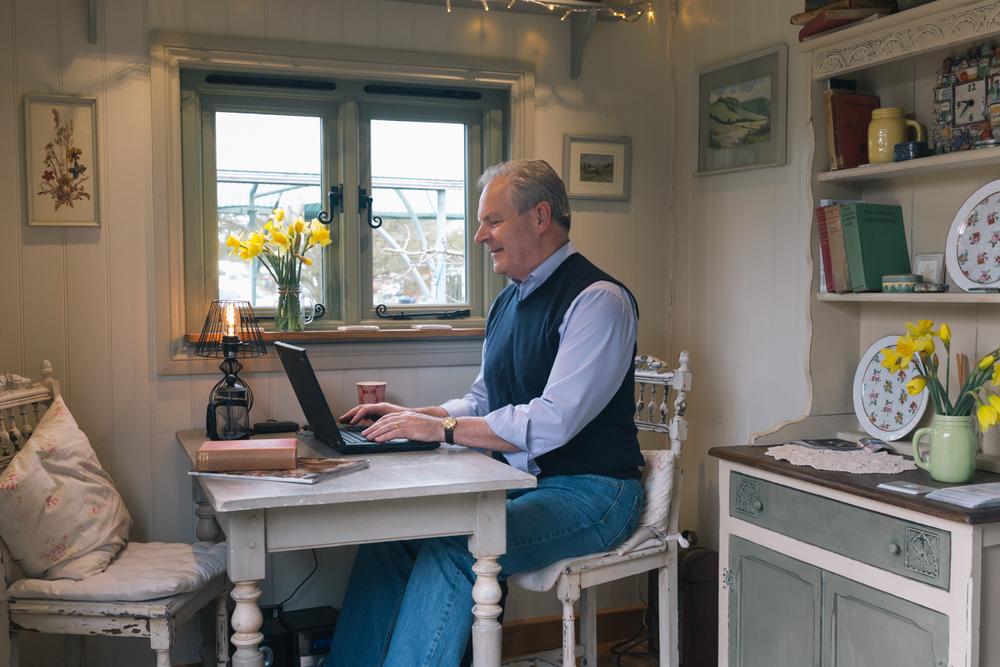 Hugh Roberts, now working in his Red Sky Shepherd's Hut home office
