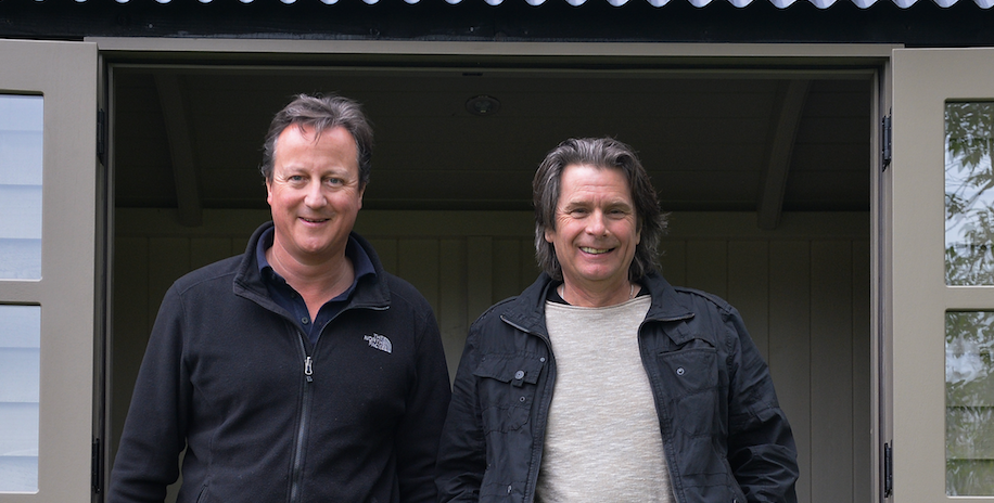 David Cameron with Paul Bennett of Red Sky Shepherd's Huts