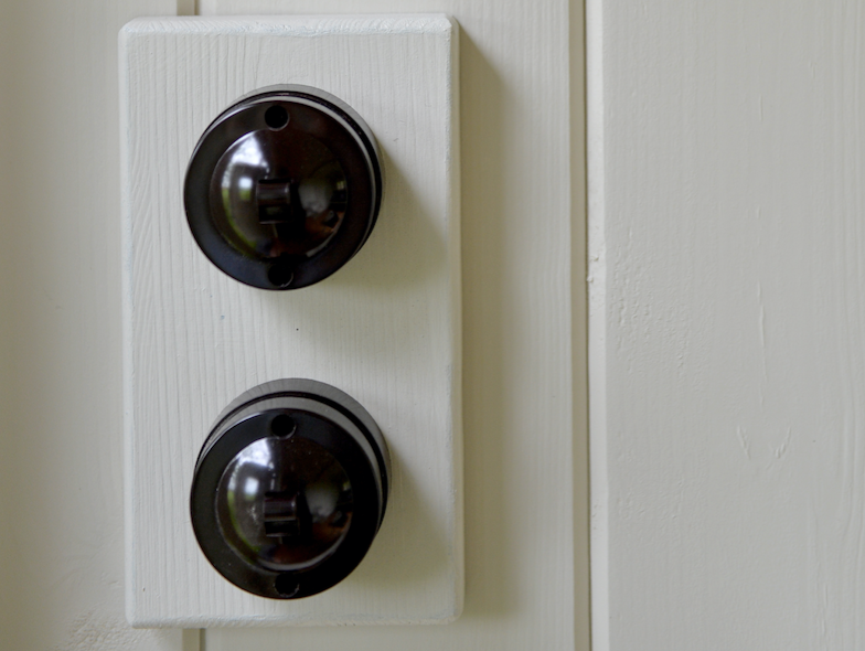 Bespoke features include retro Bakelite-style dimmer switches and Farrow and Ball colours.