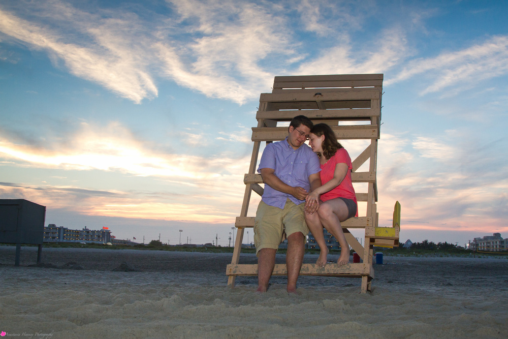 Engagement Photographer on Wildwood New Jersey Beach at Life Guard Tower during Sunset She Said Yes