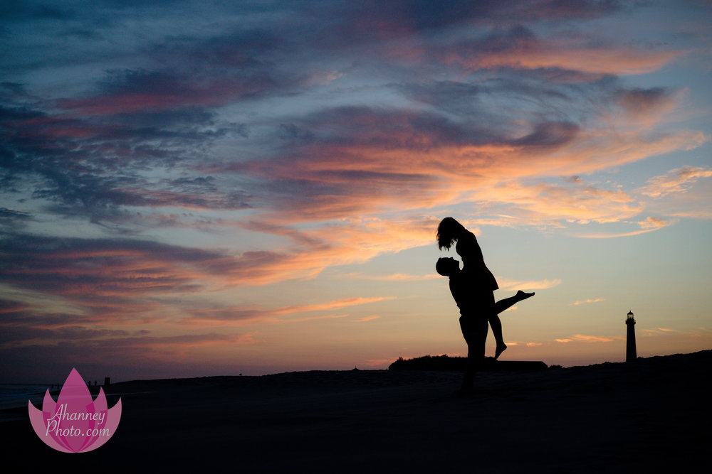Engagement Photographer in Cape May New Jersey on Beach near Lighthouse at Sunset She Said Yes
