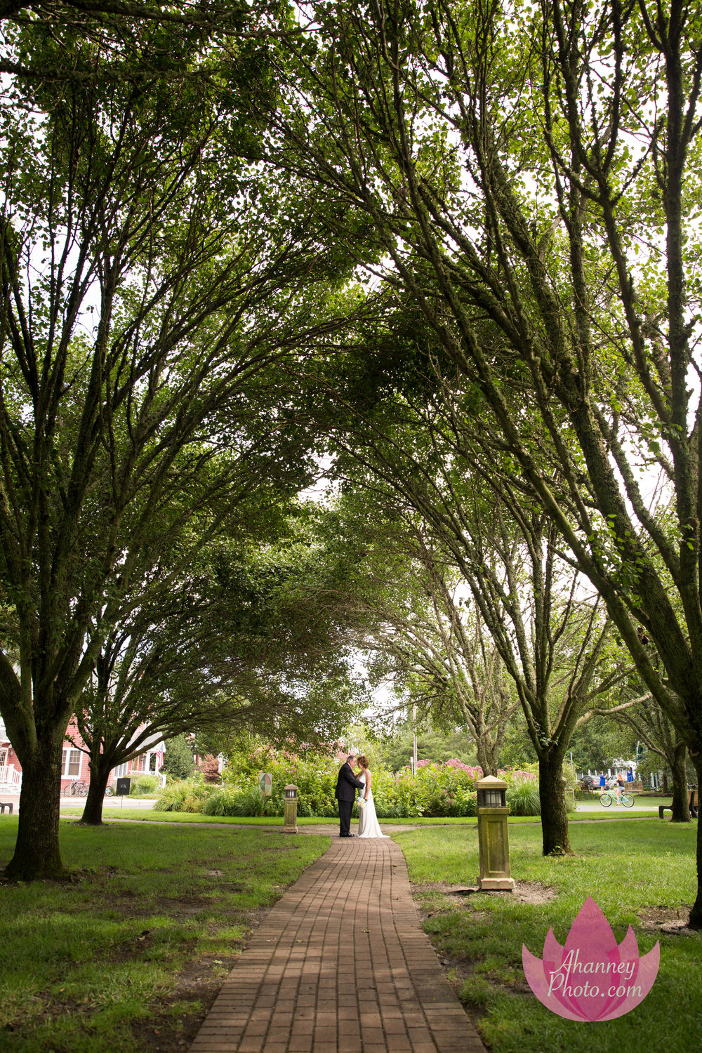 Bride and Groom on Tree Covered Path Wedding Photography of Groom and Bride Doorway ChurchThe Grand Hotel Cape May New Jersey Anastasia Hanney Photography AHanneyPhoto