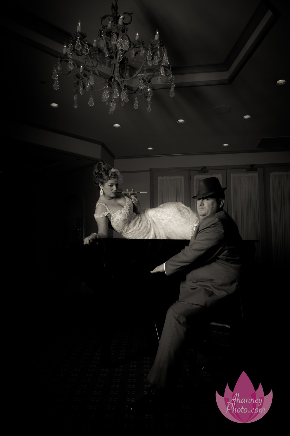 Bride on Piano and Groom