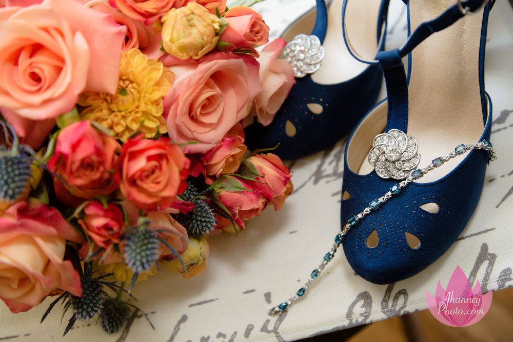 Wedding Photography of Blue Shoes and Bouquet before ceremony at National Shrine Saint Rita of Cascia in Philadelphia and reception at Lucien's Manor in Berlin NJ by Anastasia Hanney Photography