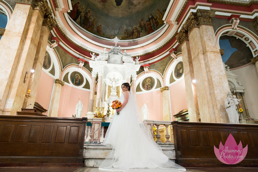 Wedding Photography of Bride at Altar hold Bouquet at National Shrine Saint Rita of Cascia in Philadelphia before Lucien's Manor Berlin NJ reception by Anastasia Hanney Photography AHanneyPhoto