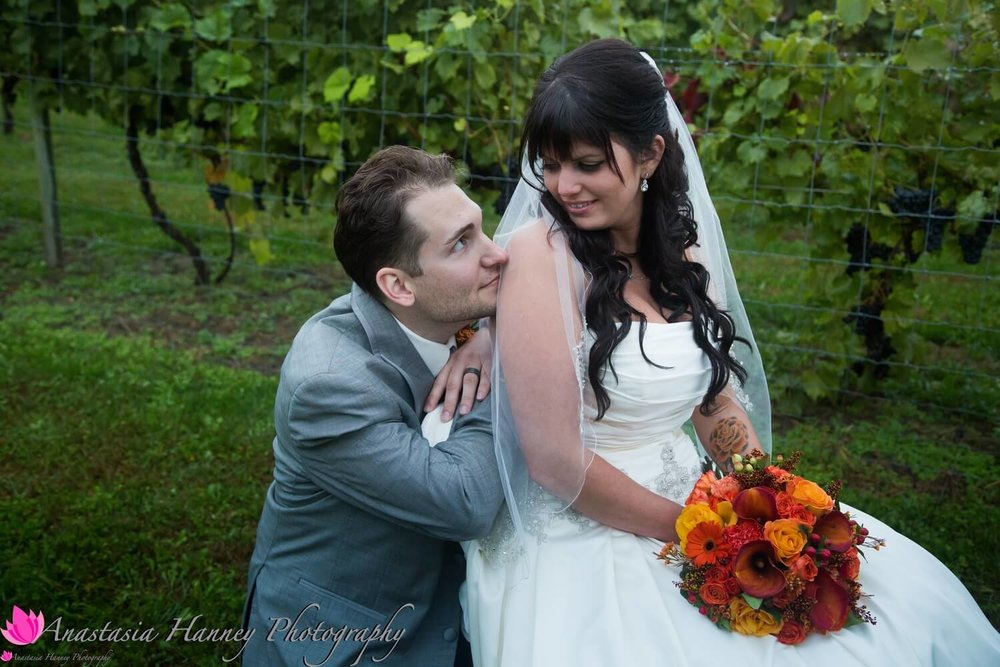 Wedding Photography of Bride and Groom in Vineyard at Valenzano Winery in Shamong New Jersey by Anastasia Hanney Photography AHanneyPhoto