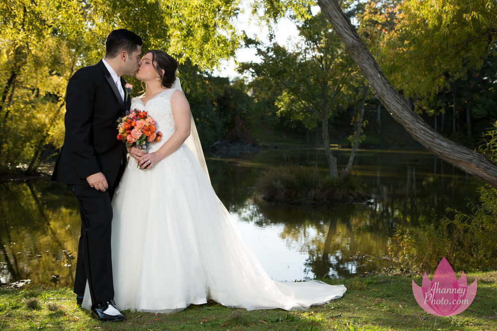 Wedding Photography of Bride and Groom Lakeside before Reception at Lucien's Manor in Berlin New Jersey after National Shrine Saint Rita of Cascia in Philadelphia by Anastasia Hanney Photography