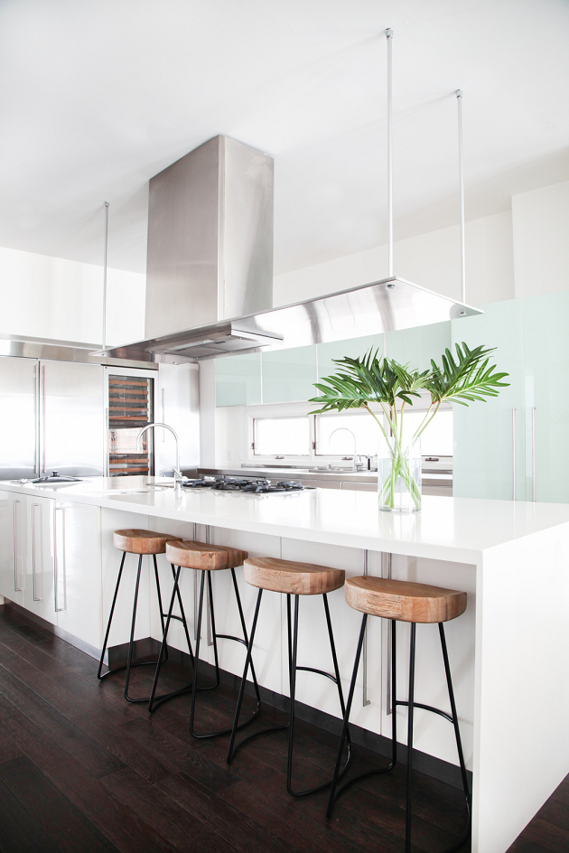 The Beach House kitchen. Design by: HomePolish, Photo by: Tessa Neustadt