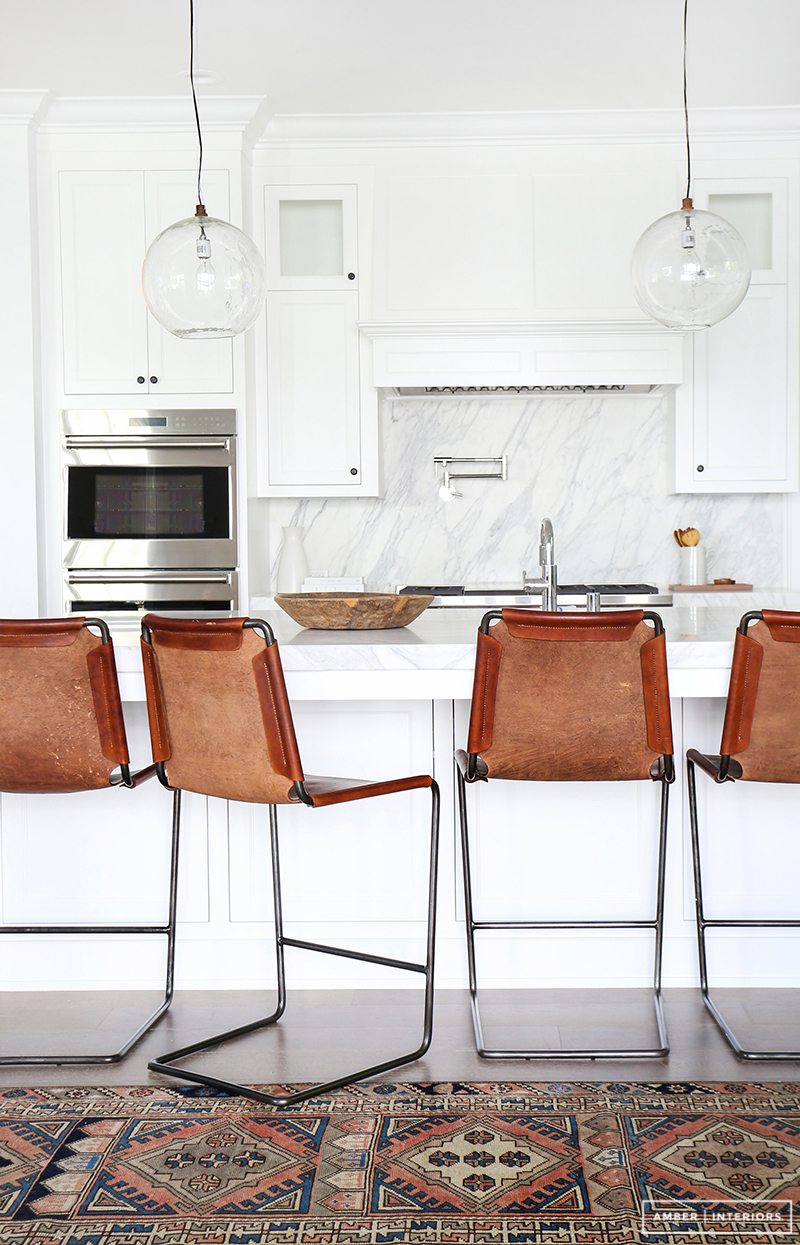 A contemporary kitchen with indie style. LOVING this eclectic look. Design by: Amber Interiors, Photo by: Tessa Neustadt