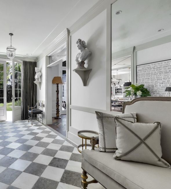 Recycled marble flooring by Exquisite Surface and ceiling lanterns from Brighton Collection were chosen for this wide gateway smartly connecting the public spaces to accommodate entertaining.
