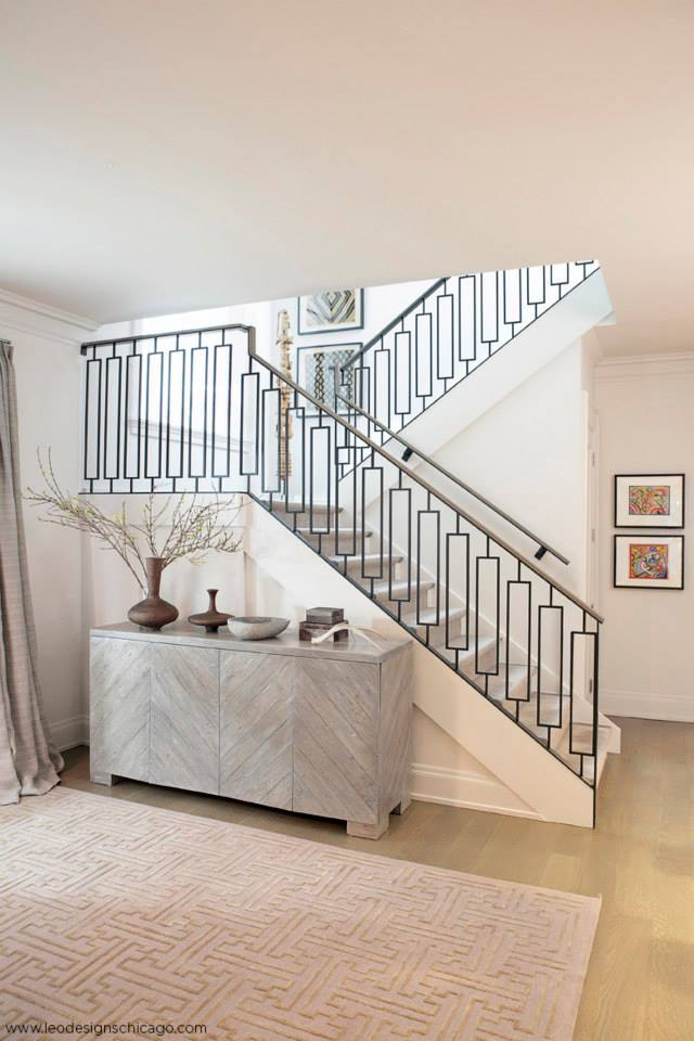 A glimpse of this contemporary stairway from a distance. Interiors by  Leo Designs Ltd.