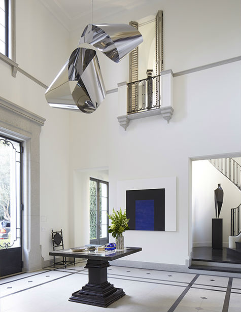 {Hanging stainless steel sculpture, Mark di Suvero; Painting, Mary Corse}