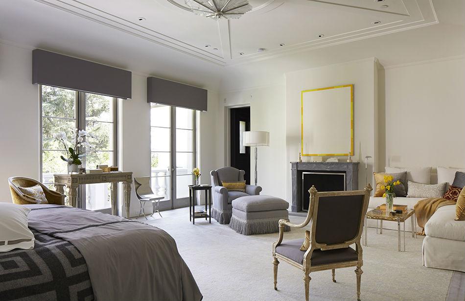 {Antique armchair, Nobilis fabric; Chair and ottoman Kravet fabric, Cache; Custom sofa, Jim Thompson fabric; Bed linens, Ann Gish;Art, Brian Sharp}