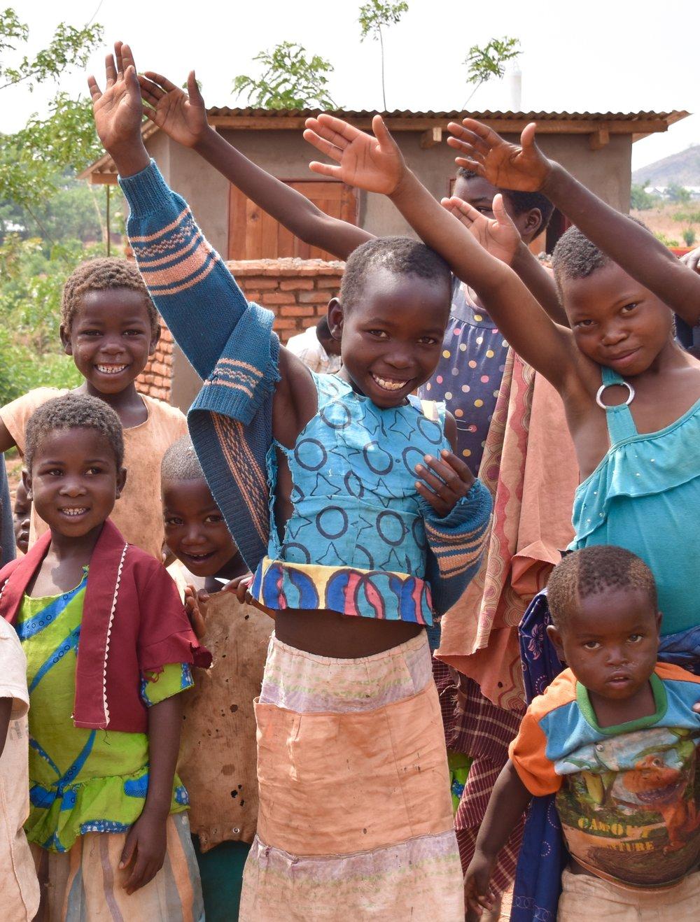 children waving malawi.jpg