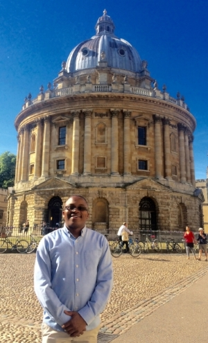 Seabelo John in front of the Radcliffe Camera, of the Bodleian Library, Oxford, England