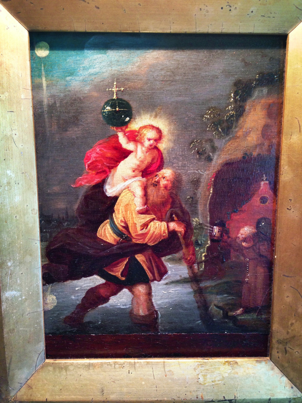 "This small, unsigned oil painting (6 3/16"" high x 5 1/16"" wide) on wood panel, probably from the 19th Century (and quite possibly earlier), is of St. Christopher carrying the Christ Child.        From Wikipedia:     "" Saint Christopher  is   venerated   by   Roman Catholics   and   Orthodox Christians   as a   martyr   killed in the reign of the 3rd-century Roman Emperor   Decius   (reigned 249–251) or alternatively under the Roman Emperor   Maximinus II Dacian   (reigned 308–313).     There are several legends associated with the life and death of Saint Christopher, which first appear in Greece, perhaps in the 6th century, and had spread to France by the 9th century. The 11th-century writer   Walter of Speyer   gives one version, but the most popular variations originate from the 13th-century    Golden Legend   .  [3]     According to the legendary account of his life Christopher was a Canaanite 5 cubits (7.5 feet (2.3 m)) tall and with a fearsome face. While serving the king of Canaan, he took it into his head to go and serve ""the greatest king there was"". He went to the king who was reputed to be the greatest, but one day he saw the king cross himself at the mention of the devil. On thus learning that the king feared the   devil  , he departed to look for the devil. He came across a band of marauders, one of whom declared himself to be the devil, so Christopher decided to serve him. But when he saw his new master avoid a wayside cross and found out that the devil feared Christ, he left him and enquired from people where to find Christ. He met a   hermit   who instructed him in the Christian faith. Christopher asked him how he could serve Christ. When the hermit suggested fasting and prayer, Christopher replied that he was unable to perform that service. The hermit then suggested that because of his size and strength Christopher could serve Christ by assisting people to cross a dangerous river, where they were perishing in the attempt. The hermit promised that this service would be pleasing to Christ.     After Christopher had performed this service for some time, a little child asked him to take him across the river. During the crossing, the river became swollen and the child seemed as heavy as lead, so much that Christopher could scarcely carry him and found himself in great difficulty. When he finally reached the other side, he said to the child: ""You have put me in the greatest danger. I do not think the whole world could have been as heavy on my shoulders as you were."" The child replied: ""You had on your shoulders not only the whole world but Him who made it. I am Christ your king, whom you are serving by this work."" The child then vanished.     Christopher later visited the city of Lycia and there comforted the Christians who were being martyred. Brought before the local king, he refused to sacrifice to the pagan gods. The king tried to win him by riches and by sending two beautiful women to tempt him. Christopher converted the women to Christianity, as he had already converted thousands in the city. The king ordered him to be killed. Various attempts failed, but finally Christopher was decapitated."""