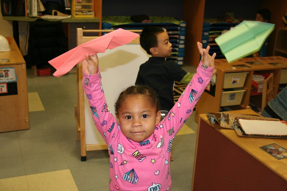 Preschooler Danielle had a fun time seeing if her planes would fly.