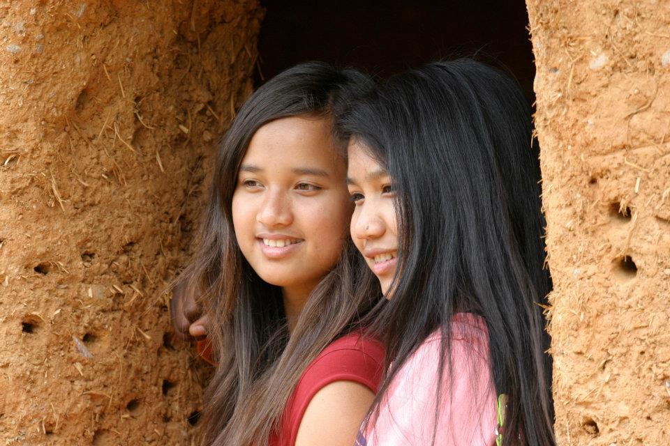 girls in cob house.jpg