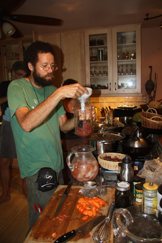 sumac tea - marc williams teaching sumac aid pmei.jpg