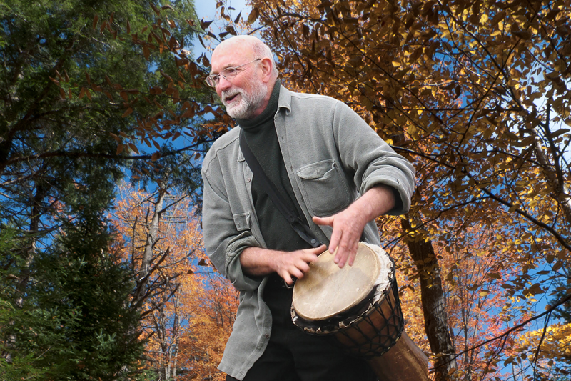 """- Part of Laurence Cole's mission is to re-acquaint people with their birthright and natural ability to make beautiful and meaningful sound together. Most of the songs he's written are short, easy to learn, chant-like songs with several layers that fit over and around each other in interesting and pleasurable rhythmic and harmonic challenges that make them fun to sing. Group singing is one of the most ancient and primal """"technologies of belonging"""" that we humans have been using since our earliest times, possibly before speech itself. When we make joyous and passionate song together, it nourishes our souls and offers an enlivening gift back to the natural world that made us and gives us our sustenance and our very being. When such an exchange is genuinely made, and the song finds its natural ending, often there is a sweet, lively silence in which we simply stand and hold the """"enchantment,"""" the sense of deep and genuine communion amongst each other and with the whole living world."""