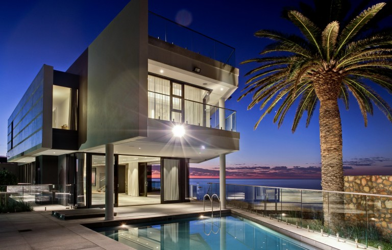 R 47 000 000 | South Africa | Lew Geffen Sotheby's International Realty   A modern masterpiece amidst coastal splendor, 14 Fulham Road, Camps Bay, is perfectly situated to enjoy the best of what this affluent suburb has to offer. With famous restaurants, savvy sidewalk cafes, palm-fringed beaches on your doorstep and the Twelve Apostles as your back drop, residents of  Cape Town 's answer to  St. Tropez  are spoilt for choice. Exuding style and sophistication fit for royalty, this residence emphasizes privacy, top security and understated elegance. Newly renovated, this modern stylish home exudes comfort, technology and opulence.