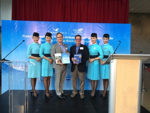 Dean Jones of Realogics Sotheby's and John Spear of Tiger Oak Media with Xiamen Airlines. Seattle-Tacoma International Airport.