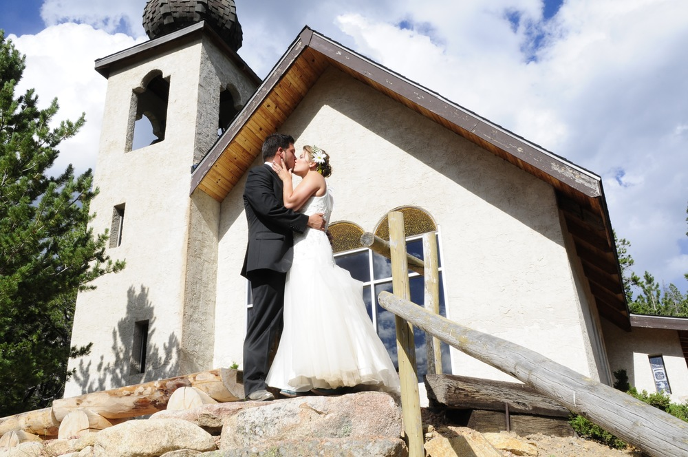 bride and groom chapel kiss