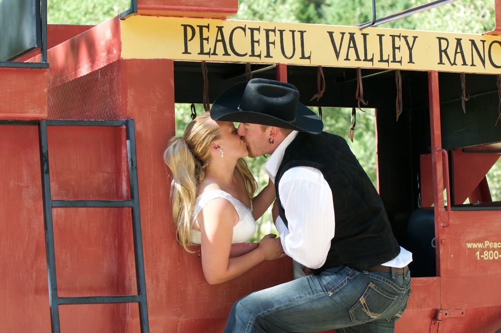 bride and groom stagecoach kiss