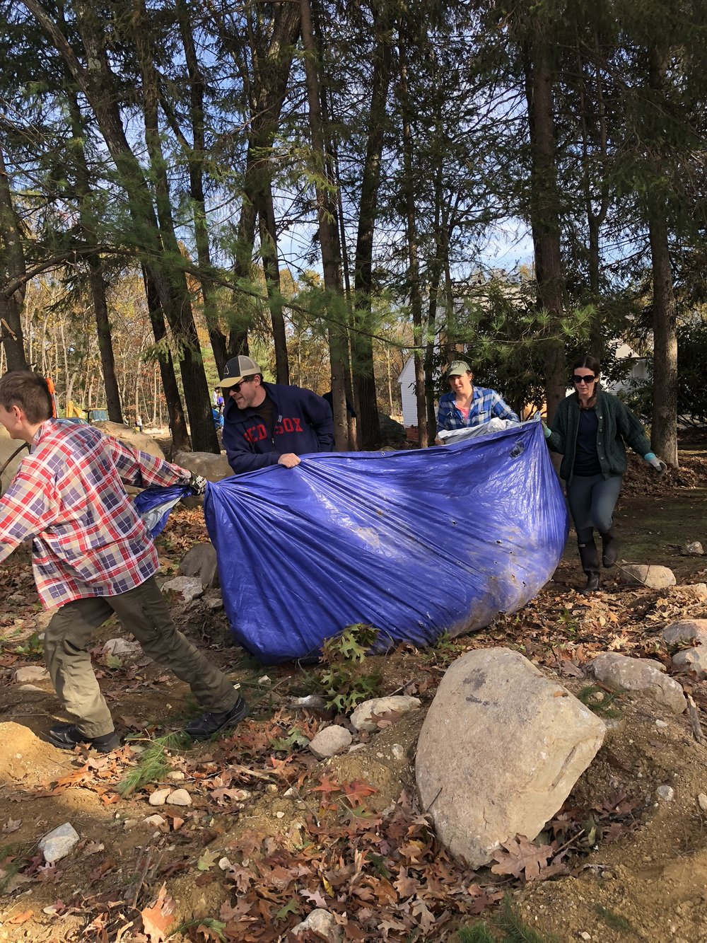 And here adults pull debris from the woods to dumpsters where children wait to tamp down the branches. We never thought we could accomplish so much in one day and still have so much fun!